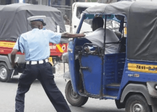 Drama as Murang'a Police officer is arrested for violently robbing a Tuk Tuk rider Sh 1,100