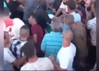 Mourners shocked as 'corpse' comes back to life moments before burial (VIDEO).