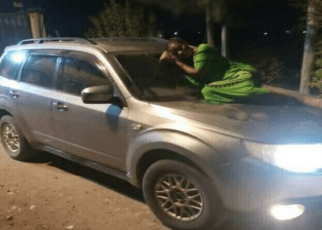 Lady spends a night at car windscreen waiting for her husband and side chick to come out