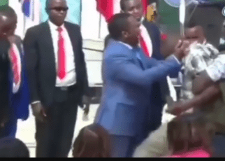 Hired man almost collapses after FAKE Pastor NG'ANG'A gave him a hot slap when performing a fake miracle-(VIDEO)