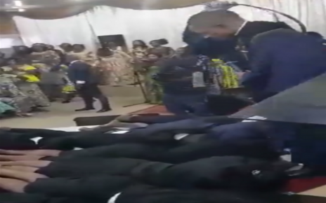 Kunyorosha dhambi– A rogue PASTOR caught on camera whipping his congregants like toddlers with an 'anointed belt' (VIDEO).
